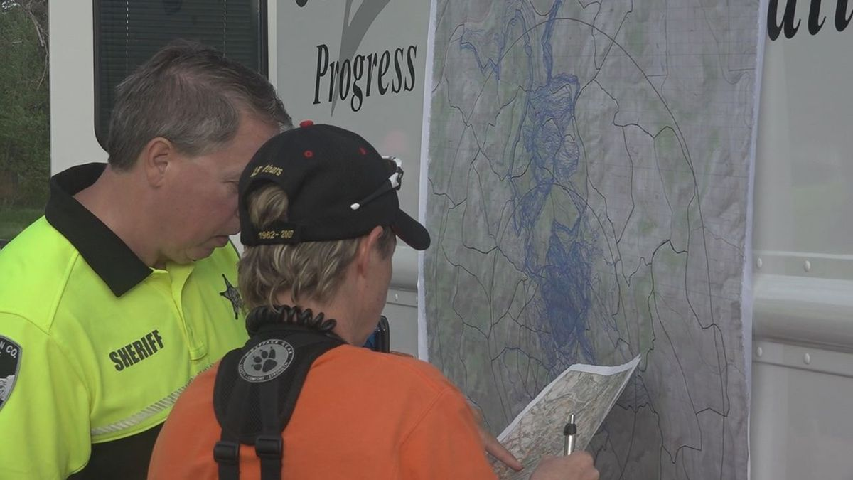 Pennington County Sheriff Kevin Thom views map of Rockerville area during the search on Saturday for Serenity Dennard. (KOTA TV).