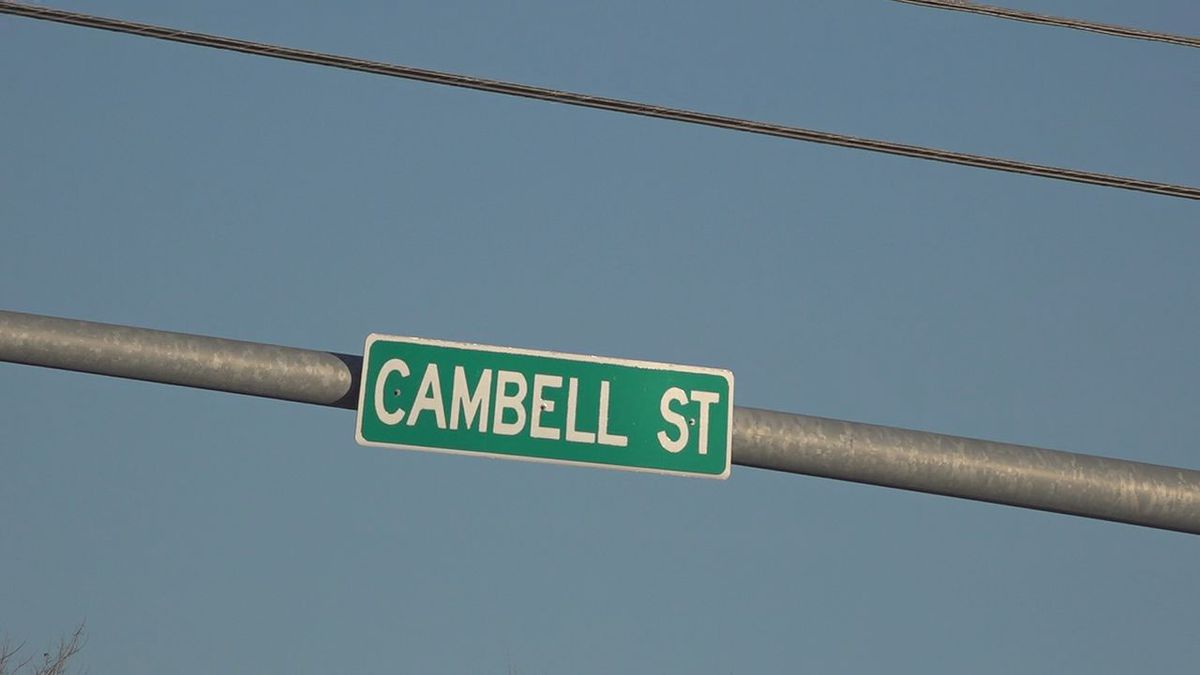 The Cambell Street bridge that runs over the train tracks and East St. Joeseph Street is...