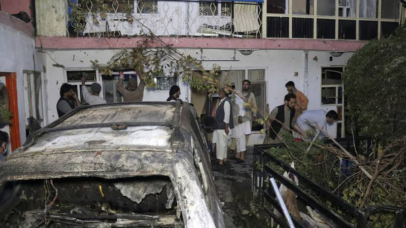 FILE - In this Sunday, Aug. 29, 2021 file photo, Afghans inspect damage of Ahmadi family house...